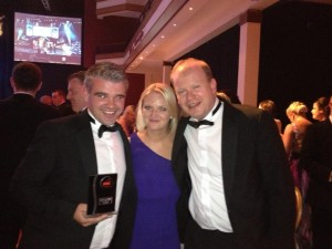 Niall Heany with his wife Laura and Chairman, Des Treacy with his AIMS runners up award